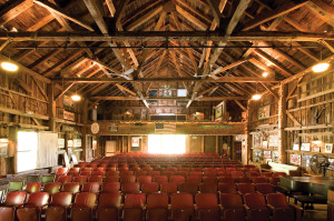 The wood interior of the Arundel Barn Playhouse echoes generations of voices. Photo: Courtesy of Arundel Barn Playhouse