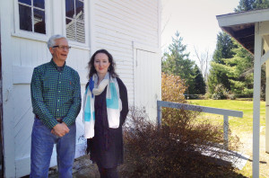 Hackmatack Playhouse founder Michael Guptill and artistic director Crystal Lisbon discuss the season outside the barn-theater in Berwick. Photo: Bob Keyes