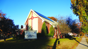 To help her church go solar, Deb McDonough and her family formed a corporation and set up a power purchase agreement for St. Ansgar Lutheran Church in Portland. The rooftop array cuts the church's electric bill, but also makes a visible statement about the values of its members, McDonough says.